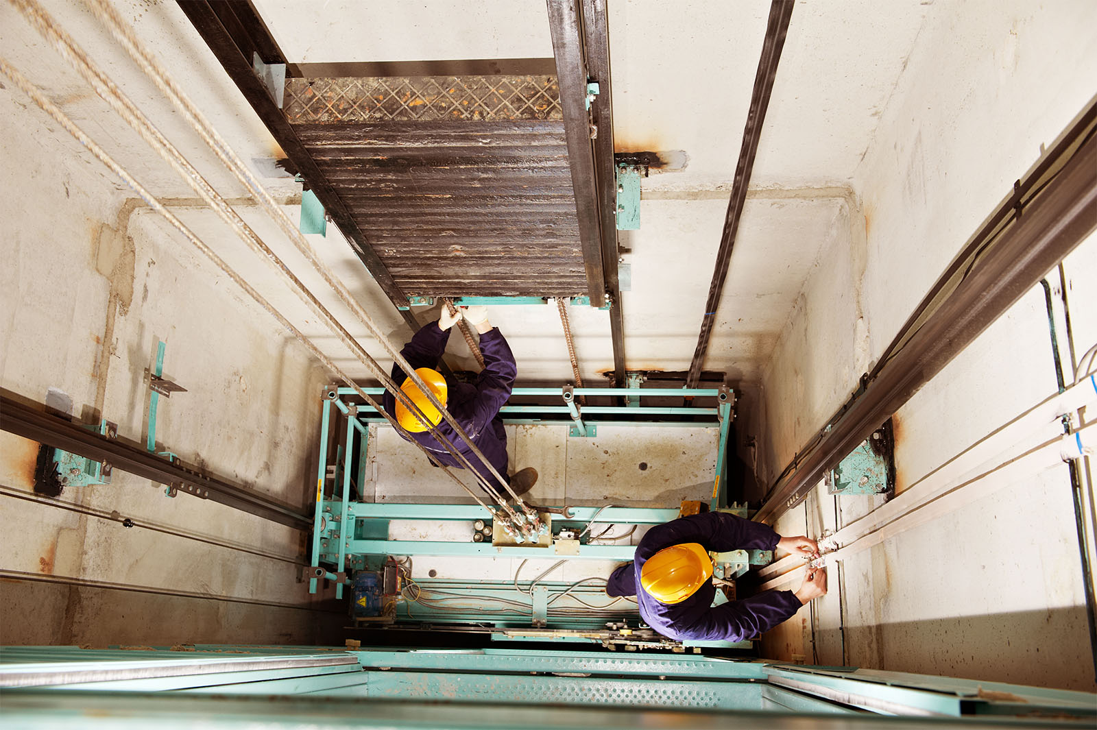 Engineers conducting reactive maintenance in a lift