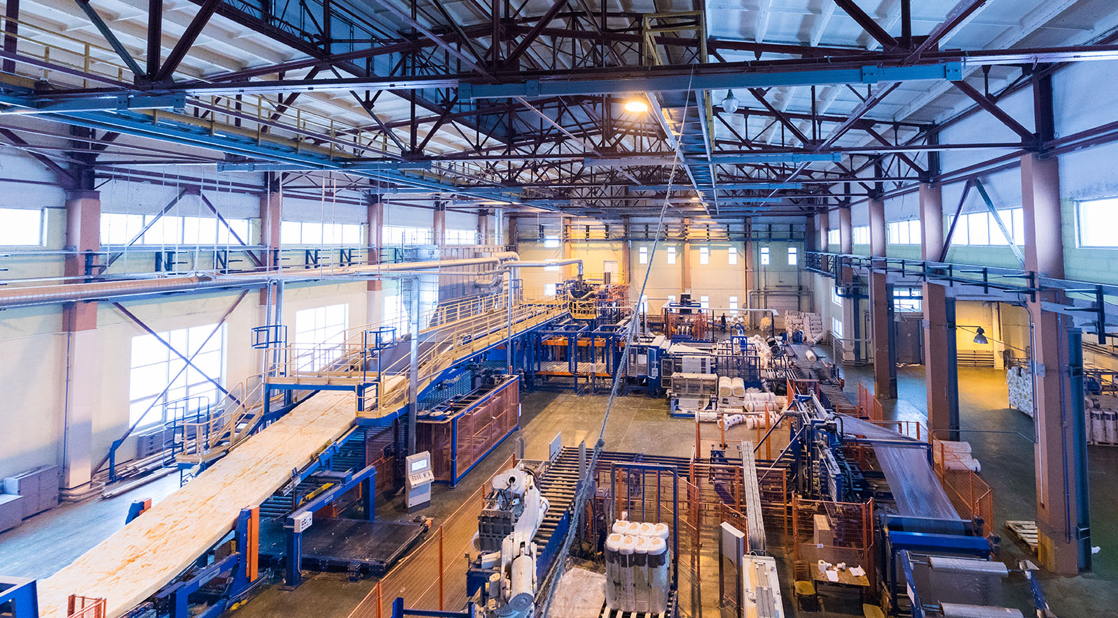 Manufacturing warehouse with lots of equipment in a warehouse