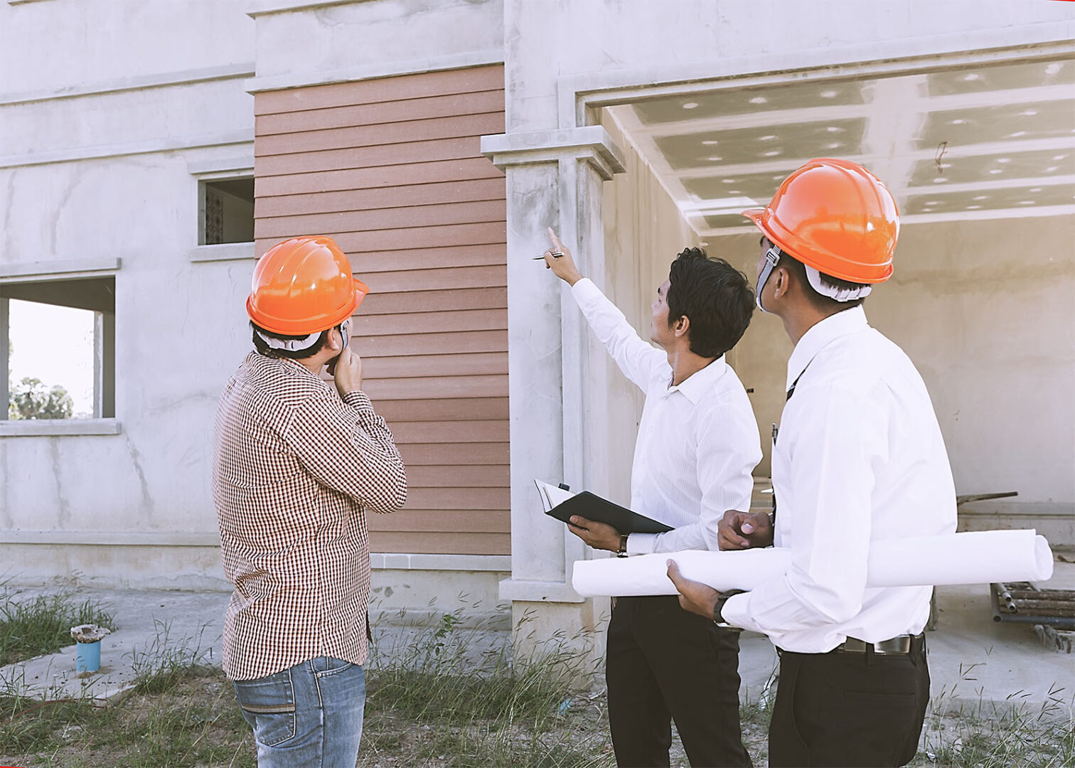 Group of engineers inspecting the client's site